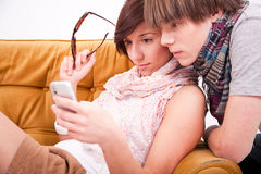 Teen boy and girl with a phone Royalty Free Stock Images