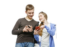 Teen boy and girl standing with mobile phones Stock Images