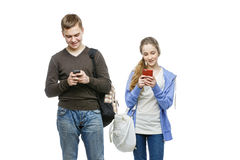 Teen boy and girl standing with mobile phones Royalty Free Stock Photo