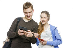 Teen boy and girl standing with mobile phones Royalty Free Stock Photos