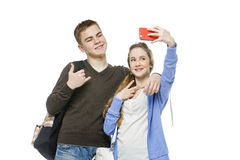 Teen boy and girl taking selfie photo Royalty Free Stock Image