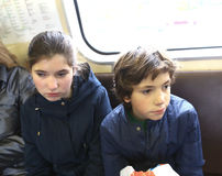 Teen boy and girl in underground train Stock Images