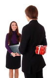 Teen boy giving a gift to a girl Royalty Free Stock Photo