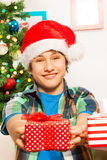 Teen boy giving a present Royalty Free Stock Photo