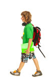 Teen boy going to school. And holding notebooks and bag isolated on white background Stock Image