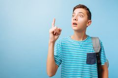 Teen boy got a great idea. An enthusiastic excited guy raises his index finger in a gesture of Eureka stock images