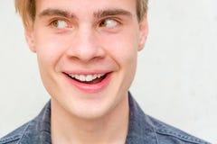 Teen boy got idea closeup portrait. Teenage boy got idea and is thinking, facial expression in closeup portrait stock photo