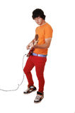Teen boy with guitar. Royalty Free Stock Images