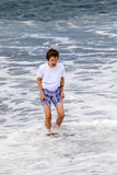 Teen boy has fun at the beach Stock Photography