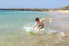 Teen boy has fun with his boogie board Stock Image