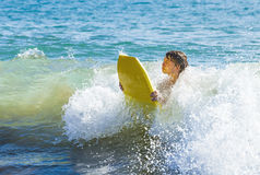 Teen Boy Has Fun Surfing In The Waves Royalty Free Stock Images