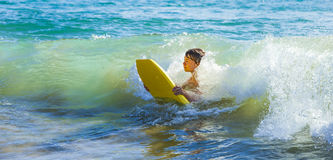Teen Boy Has Fun Surfing In The Waves Royalty Free Stock Photography