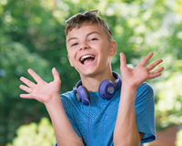 Teen boy with headphones. Beautiful smiling teen boy with headphones and sunglasses Royalty Free Stock Photo