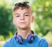 Teen boy with headphones. Portrait of a teen boy 12-14 year old with sunglasses Royalty Free Stock Images