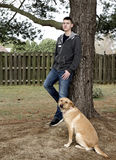 Teen Boy with his Dog Outdoors Royalty Free Stock Image