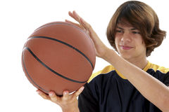 Teen Boy Holding Basket Ball Over White Royalty Free Stock Image