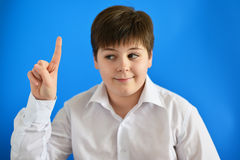 Teen boy holding his finger up, he came up with  idea Stock Images
