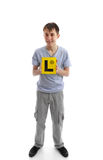 Teen boy holding L learner plates Stock Image