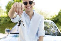 Teen boy holding car keys. A teen boy holding up car keys Stock Image