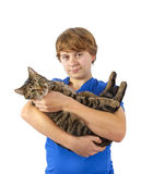 Teen boy holds his tabby cat in his arms Royalty Free Stock Photos
