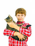 Teen boy holds his tabby cat in his arms Stock Photos