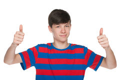 Teen boy holds his thumbs up Stock Image