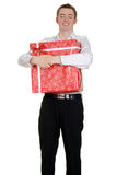 Teen boy hugging christmas present Royalty Free Stock Photo