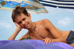 Teen boy on inflatable mattress Royalty Free Stock Images