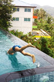 Teen boy jump in the water  swimming pool Royalty Free Stock Image