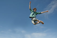 Teen boy jumping Royalty Free Stock Photo