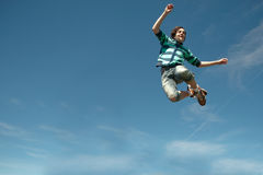 Teen boy jumping Stock Photo