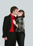 Teen boy kissing girl on cheek. Attractive caucasian teen couple smiling Royalty Free Stock Photos