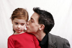 Teen boy kissing little sister Royalty Free Stock Photography