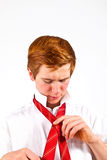 Teen boy knots his tie Royalty Free Stock Photography
