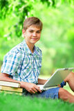 Teen boy with laptop Stock Photos