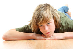 Teen boy laying his head on his hands Royalty Free Stock Image