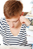 Teen boy learning at the desk  Stock Photography