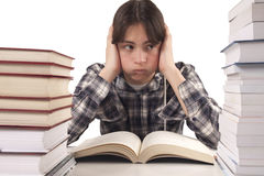 Teen boy learning at the desk Stock Images
