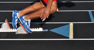 Teen Boy Leaving the Starting Blocks. At the Start of a Race Royalty Free Stock Images