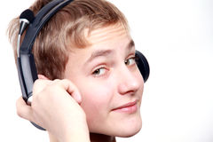 Teen Boy listening to headphones Royalty Free Stock Photography
