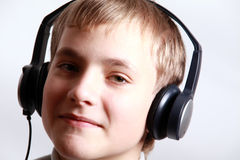 Teen Boy listening to headphones Stock Photo
