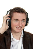 Teen boy listening to music with headphones Stock Images
