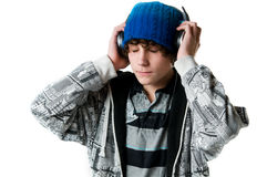 Teen boy listening to music on his headphones Royalty Free Stock Photo