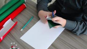 Teen Boy make homemade gifts for Christmas stock footage