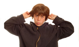 Teen boy making funny face. Attractive young teenage boy making silly face - isolated on white background Stock Photo