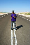 Teen Boy in Middle of Highway stock photo