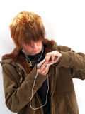 Teen Boy with MP3 Player. Teenage boy listening to a MP3 player Royalty Free Stock Photo