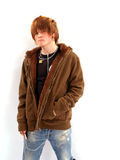 Teen Boy with MP3 Player. Teenage boy listening to a MP3 player Royalty Free Stock Photos