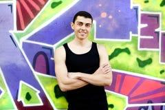 Teen boy near graffiti wall Royalty Free Stock Image