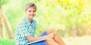 Teen boy with notebooks Royalty Free Stock Photos
